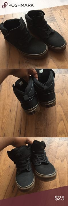 Kids sneakers A pair of black canvas material Vans kids. NWOT never used. Not my son style. In great condition. Size 5.5y. Really a nice pair of every day sneakers. The soles are a light brown Vans Shoes Sneakers