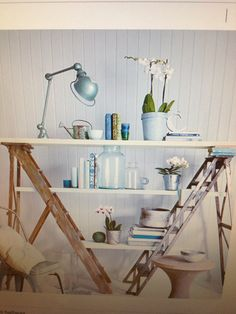 Ladders as bookshelves - love this! If only I had more space!