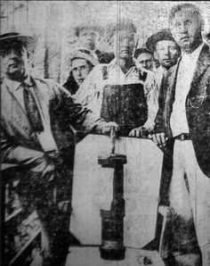 Coal miners display bombs dropped by the govt of United States on its own citizens during the Battle of Blair Mountain, the largest armed uprising in the US after the Civil War.  For five days in 1921, in Logan County, West Virginia, between 10,000 and 15,000 coal miners confronted an army of 30,000 police and strikebreakers backed by coal operators... The battle ended after approximately one million rounds were fired, and the United States Army intervened by presidential order.
