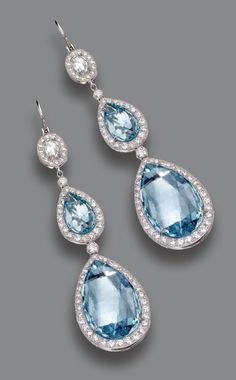 PAIR OF AQUAMARINE AND DIAMOND PENDANT-EARRINGS.  The pendants set with 4 pear-shaped aquamarines weighing a total of approximately 16.90 carats, the tops set with 2 cushion-shaped rose-cut diamonds, all within borders of numerous small round diamonds, the total diamond weight approximately 1.60 carats, mounted in platinum.