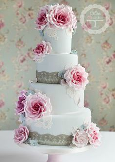tiered cake with rose, hydrangea, lace and a birdcage - by Cotton & Crumbs