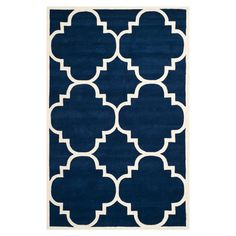 Dark blue wool rug with an ivory quatrefoil motif. Hand-tufted in India.  Product: RugConstruction Material: Woo...