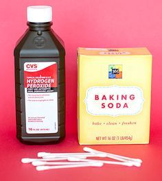 Mix a dab of toothpaste, hydrogen peroxide and baking soda together until you get a paste-like texture. Then, use one end of a cotton swab to wipe down each tooth so it's dry and the other to apply the paste you just made. After one minute has passed, brush the blend off with a toothbrush. Repeat this a few times a week until you've reached the desired effect.