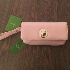 NWT Kate Spade Clutch in Blush w/ Pyramid Clasp Brand new Kate Spade Clutch in light pink/blush. Silver hardware. Pyramid clasp rotates to lock and unlock the opening. Wrist strap for easy carrying. Perfect for formal events or an easy carry all. Care card included. Approx. measurements: 8.5in length, 5in tall, 1.75in deep. kate spade Bags Clutches & Wristlets