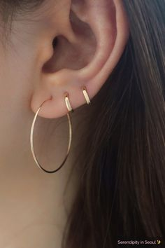 Solid 14K gold tiny huggie hoop earring in 6mm inner diameter. Modern, simple yet elegant! This tiny hugging hoop is perfect for upper ear cartilage piercings or second/third hole piercings. Minimal style and perfect to wear indefinitely!   6mm huggie hoop earring is made from 14K REAL GOLD, and will not tarnish. Perfect for everyday wear!   Emerald Earrings, Crystal Earrings, Sterling Silver Earrings, Silver Jewelry, Silver Ring, Gothic Earrings, Ear Jewelry, Jewelry Accessories, Fine Jewelry