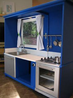 I love the window in this play kitchen made from an entertainment unit.