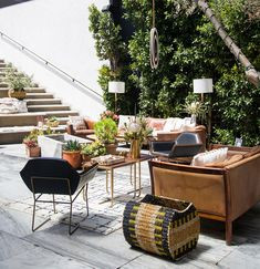Looking to make your outdoor space even more welcoming? These patio decorating tips are designer-approved! Indoor Outdoor Living, Outdoor Spaces, Outdoor Decor, Adirondack Furniture, Outdoor Furniture Sets, Evergreen House, Deck Decorating, Diy Patio, Patio Ideas