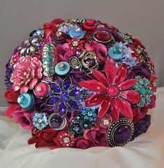 Fuchsia, aqua, purple brooch & flower bouquet. #BluePetyl #jeweledbouquet #bouquet
