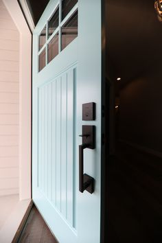 Colorful entry doors liven up a home's curb appeal. Be bold, use a color that will offer a smile to those passing by or stopping by for a visit. This homeowner chose Robin's egg blue for their Craftsman/Bungalow style entry. For more inspiration and our Dealer Locator visit us at: www.bayerbuilt.com Exterior Doors, Entry Doors, Garage Doors, Wood Grain Texture, Craftsman Bungalows, Concrete Floors, Curb Appeal, Egg, Farmhouse