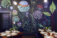 "Lucy Tiffney ""Thanks @churchsttavern for posing this pic of my allium mural #mural #muralart…"""