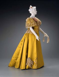 1895, France  Evening dress by Rouff  Silk satin, embroidered with silk and metallic threads, sequins and rhinestones; lace ruffles  MFA Boston