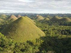 (Soak up the bizarre landscape of Bohol's iconic Chocolate Hills, conical brown-green mounds said to be the calcified tears of a broken-hearted giant.) Things not to miss in Philippines Chocolate Hills, Boracay Island, Cebu City, Picture Postcards, Plan Your Trip, Asia Travel, Monument Valley, Photo Galleries, Tropical