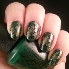 Green christmas nails with gold snowflakes.  OPI Christmas gone plaid, snowflakes stamped with OPI Rollin in cashmere and Bundle Monster stamp BM-H02
