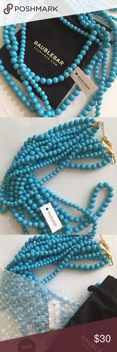 """Bauble Bar Necklace - NWT Never Worn Bauble Bar's Bold Multistrand Beaded Statement Necklace - I LOVE this necklace. I just ended up not needing it for a wedding I was attending. It's a beautiful Turquoise color in person. Dimensions: 18"""" is the shortest strand length, 31.5 is the longest strand, 3"""" extender. Mixed diameter beads and gold tone lobster clasp. It's still wrapped in the bubble wrap, inside of the jewelry pouch. BaubleBar Jewelry Necklaces"""