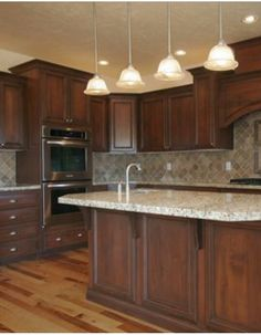 these gorgeous cambria kitchen cabinets in harvest are part of our