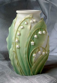 A medium-sized vase, beautifully sculpted and cast in bonded marble then expertly hand-painted.