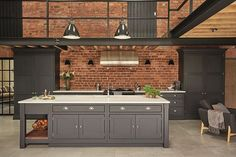 Industrial style shaker kitchen painted in charcoal grey against an exposed brick wall and featuring lots of original features. Kitchen by Tom Howley Industrial Kitchen Design, Industrial House, Industrial Interiors, Modern Kitchen Design, Interior Design Kitchen, Modern Industrial, Industrial Table, Industrial Bookshelf, Industrial Windows