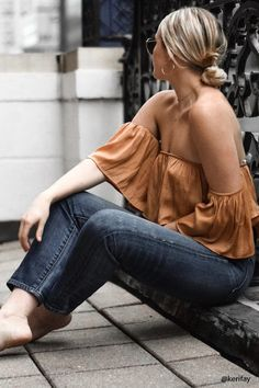 Forever 21 Contemporary - A satin top featuring an elasticized off-the-shoulder neckline, a flounce layer, and short sleeves.