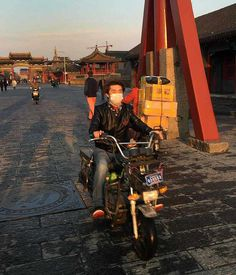 My favourite motorcyclist, riding down the street outside the ancient Imperial Palace, Shenyang, Liaoning Province, China 2016