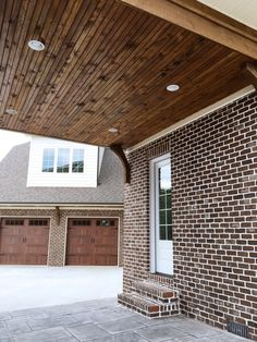 Dark brown wood blend perfectly with Casa Grande Brick by Pine Hall in this portico. White Mortar.