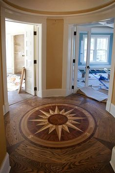 compass rose wooden floor inlay ....yes, definitely....somewhere in my house, perhaps not this design and probably not this placement, but there should be one, for certain.