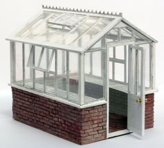 Greenhouse if I decide to use cinderblock for the foundation Miniature Greenhouse, Greenhouse Shed, Small Greenhouse, Miniature Plants, Miniature Houses, Porches, Concrete Walkway, Greenhouse Interiors, Glass House