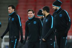 Lionel Messi, Luis Suarez and Gerard Pique of Barcelona in discussion during a FC Barcelona press conference ahead of their UEFA Champions League round of 16 first leg match against Arsenal at the Emirates Stadium on February 22, 2016 in London, United Kingdom.