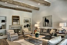 Segreto Secrets - Design Chic Beautiful wood beams and love a cowhide rug!