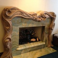 Hand Carved Fire Surround/Mantle custom made by Wood Carving/Michael McConnell. Reminds me of Harry Potter!