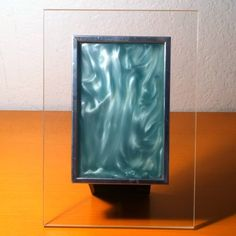 Kalliroscope with heating element stand: visualizing convection currents. Invented and produced by Paul Matisse in the 1970s, suspended microscopic flat crystals reflect light and allow visualization of the fluid's motion. #rheoscopicfluid #rheoscopic #Matisse #convection #kineticart #fluiddynamics #1970 #1970s #Calder #kineticsclupture #kalliroscope #physics #physicstoy #art #psychedelic #lavalamp #science #scienceisawesome