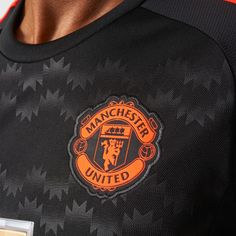 Manchester United 2015/16 third kit. Striking new solar red elements on black with graphic chest pattern. | adidas UK