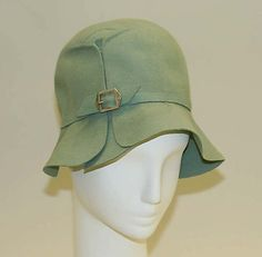 """Cloche, 1928. Sage green wool with metal buckle. Label states """"Thérèse - French Shop, Atlantic City."""" Met Museum."""