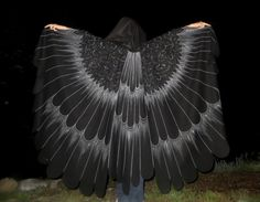 This lightweight and comfortable open-front bird cloak will add an element of class and fantasy to any costume. Patterned after the real image of a