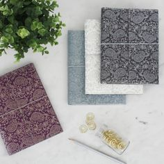 Our beautiful and practical notebooks are made from recycled materials. Finished with a textured look (a bit like leather) they are eco and animal friendly. All of our beautiful rich prints and patterns are hand-screen printed using eco-friendly dyes. A5 Notebook, Lined Notebook, Notebook Covers, Magazine File Holders, Beautiful Notebooks, Paisley Design, Paper Cover, How To Make Paper, Recycled Materials