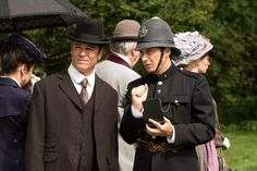 Detective Murdoch (Yannick Bisson) and Constable Crabtree (Jonny Harris) observe the funeral attendees.