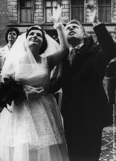 297 Dieter and Monika Marotz of Bernauerstrasse, Berlin, wave to relatives after their wedding(Photo by Keystone/Hulton Archive/Getty Images) On Your Wedding Day, Wedding Tips, Wedding Photos, Bridal Wardrobe, East Germany, The Secret History, Berlin Wall, Historical Pictures, Vintage Photographs