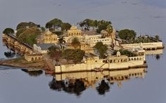 India // Things not to miss #25 Udaipur Arguably the most romantic city in India, with ornate Rajput palaces floating in the middle of two shimmering lakes.   Read more: http://www.roughguides.com/destinations/asia/india/things-miss/#ixzz2tUghIkjY