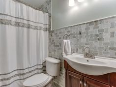 Transitional Full Bathroom with Wall Mounted Sink, High ceiling, tiled wall showerbath, Flat panel cabinets, Wall sconce