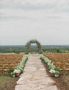 flower arch ceremony....such a great setting