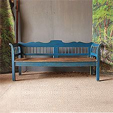 A Windsor style spindled bench with decorative curves