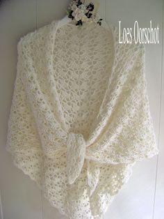 Cream colored lacy crochet shawl crocheted by Loes Oorschot as seen on Scrapaloes blog from the free pattern, South BaySouth Bay Shawlette from Lion Brand Yarn