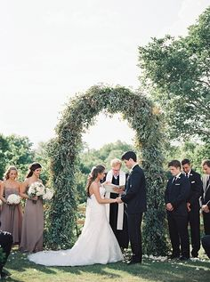 greenery arch at the ceremony | Tracy Enoch