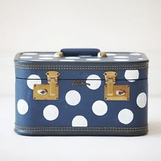 We could do so much with these upcycled vintage train cases. Thinking...cord hider?