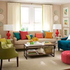 Love the pops of color in a neutral living room - the lamps are so much fun!