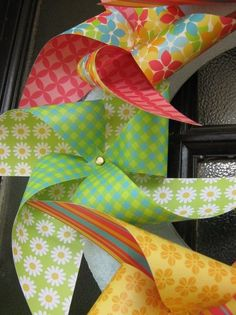 "A wreath created from pinwheels - that says ""Hello, can so come out to play"" on any door!"