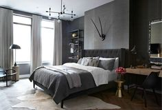 Into the Dark  Jennifer Wolf A New York City bedroom lined in charcoal-hued grasscloth highlights modernist accents like a dome-shaped table lamp, molecular chandelier, and sculptural side table. lonny.com