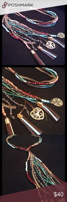 """BOHO TASSEL AND BEAD NECKLACE BOHO TASSEL AND BEAD NECKLACE WITH STRANDS OF CRYSTALS AND TWO PENDANTS ONE SAYING LOVE AND THE OTHER JUST A DESIGN. LENGHT IS JUST AROUND 40"""". BEAUTIFUL. NEW IN BAG. NO CLOSURES JUST SLIP OVER HEAD. boutique Jewelry Necklaces"""