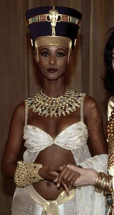 "Iman, styled as Egyptian Queen, Nefertiti. Photo: Natalie Eckman. On December 7, 1912 – ""Pharaonic Queen Nefertiti bust, wife of the Pharaoh Akhenaten's was discovered in the Tel el-Amarna area of Minya in southern Egypt."""
