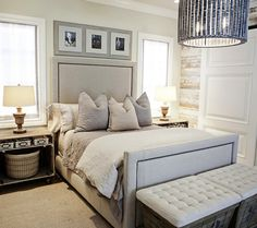 Sophisticated bedroom with rustic wood paneled walls, linen bed with nailhead ...
