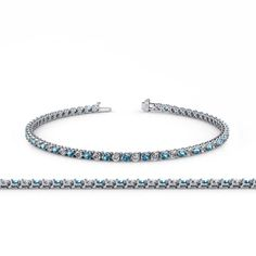 Blue Topaz and Diamond (SI2-I1, G-H) 2.4mm 3-Prong Tennis Bracelet 3.13 ct tw in 14K White Gold. 29 Round Diamond of 1.45 ct tw & 28 Round Blue Topaz of 1.68 ct tw set using 3-Prong Setting. SI2-I1-Clarity, G-H-Color Diamond & SI1-SI2-Clarity, Blue Color Blue Topaz. Gemstones may have been Treated to Improve their Appearance or Durability & may Require Special Care. The Natural Properties & Composition of Mined Gemstones define the Unique Beauty of each Piece. The Image may show Slight...